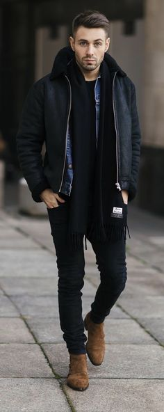 Fall outfit inspiration with a black jacket black scarf denim jacket black t-shirt black slim cut jeans brown suede boots. model unknown. #fallfashion #falloutfits #menswear #menstyle #mensapparel #scarf #boots #denimjacket #mensfashion