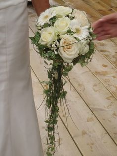 Opposite, trailing through handle of bouquet