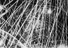 This photograph was taken on Jan. 31, 1941, during a nigthtime air raid carried out by the Royal Air Force above Brest, France. It gives a graphic impression of what flak and anti-aircraft fire looks like from the air. In the period of three to four seconds during which the shutter remained open, the camera clearly captured the furious gunfire. The fine lines of light show the paths of tracer shells, and the broader lines are those of heavier guns. Factories and other buildings can be seen…