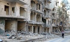 Russia tells UN it will pause bombing of eastern Aleppo A man walks past damaged buildings in Aleppo