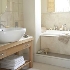 Small bathroom, natural stone tiles seaside feel