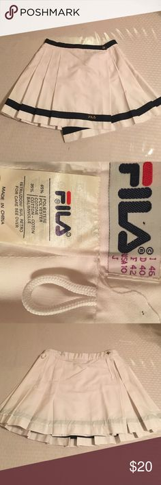 Fila vintage tennis skirt White with navy blue trim and gold etching. Super cute for activewear or costume. 65% polyester 35% cotton Fila Skirts Mini