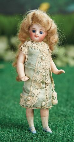 """5"""" French All-Bisque Mignonette in Original Costume~~~French, circa 1882. Value Points: beautiful face with entrancing large eyes, original wig, original silk and lace costume."""