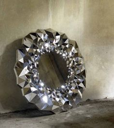 Jake Phipps has released a new mirror design, Stellar that twinkles like a star. Its circular design is made of 750 tiny angled mirrors inspired by the Spiegel Design, Circular Mirror, Amethyst Geode, Mirror Art, Magic Mirror, Hallway Mirror, Bathroom Mirrors, Wall Mirrors, Mirror Ideas