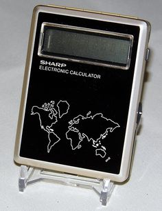 Vintage Sharp Electronic LCD Calculator, Model Made in Japan, a Combination of a Clock, Stop Watch and Calculator in a Very Small Case, Circa 1977 Small Case, Calculator, Clock, Japan, Pocket, Electronics, Watch, Model, How To Make