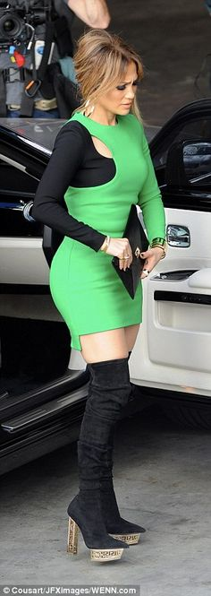Fashion forward: The dress featured an asymmetrical layout with one black sleeve and the other green, with a small cutout where the colors met on the right shoulder