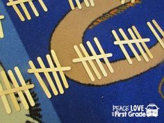 Use popsicle sticks to help children work on counting with tally marks.
