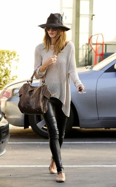 Rosie Huntington-in leather pants, pink ballet flats, and this awesome cream sweater with an asymmetrical hem.