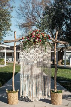 Add a beautiful touch of handmade decor for your wedding ceremony, reception, or simply use as a unique piece to adorn your home. Handmade with 100% cotton rope. This piece measures 3.5 ft wide and 6 ft long on a 4 ft dowel. However the measurements can be customizable. Ive created