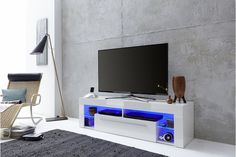 High gloss white TV Stands With Led Lights modern white tv stand # Tv Stand With Led Lights, Blue Led Lights, Large Tv Stands, White Tv Stands, Blue Tv Stand, High Gloss Tv Unit, Tv Stand Furniture, Corner Tv Unit, Modern Tv Units
