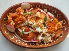 Simply one of the best Mexican breakfast dishes around! Red Chilaquiles are spicy, crunchy and have loads of cheese, making it a fabulous start of the day. Mexican Menu, Mexican Breakfast Recipes, Breakfast Dishes, Mexican Dishes, Mexican Food Recipes, Ethnic Recipes, Breakfast Casserole, Breakfast Ideas, Salads