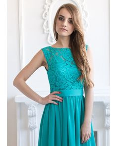 Long turquoise bridesmaid dress with a belt that is made from chiffon and lace. Zipper is in the side seam. The dress is made with a lining.