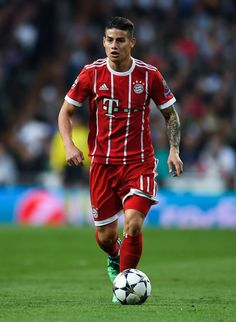 James Rodriguez of FC Bayern Muenchen runs with the ball during the. Champions League Semi Finals, Uefa Champions League, David Ramos, Hot Rugby Players, Soccer Socks, James Rodriguez, Football Jerseys, Real Madrid, Running