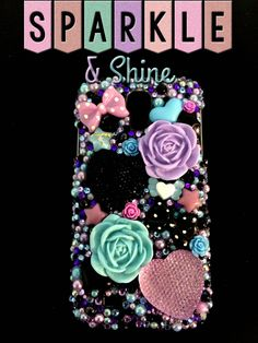 Got a little goth in you? Then you NEED this phone case! A perfect blend of lavender,sky blue, and blacks, this case really pops! Big giant roses, and jumbo crystal hearts turn this case into a real eye catcher!  Made to fit the Samsung Galaxy S4.  (Any overcharges for shipping will be refund...