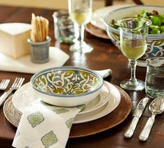 Dress your dining table with contrasting accents like white plates, woven chargers and pops or color.