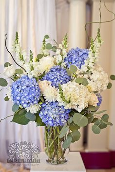 White and blue hydrangeas with snap dragons