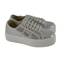 2af422d8967  Zapatillas deportivas en tejido especial de glitter plata con plataforma  seguida de VICTORIA. Zapatillas