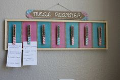 Meal planner, calendar, to-do list...     Just some clothes pins and a board you can find at Michaels.  Add a little of your own style then voila!