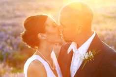 outdoor bride and groom portrait in wildflowers