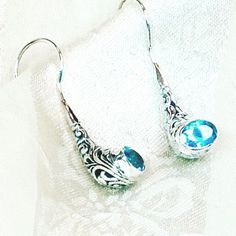 Swiss Blue Topaz Earrings, Filigree Pipe Design, Bali Sterling Silver, Handmade Jewelry, NorthCoastCottage Jewelry Design & Vintage Treasures. What a pair or head-turners! Each 1/2CT Swiss blue topaz oval is set in a lovely Bali-style filigreed sterling silver pipe setting that is