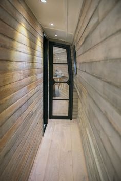 This is a really cool alternative to a traditional french door. - KL In this modern boathouse, a narrow wood-lined hallway leads to the bedroom and bathroom. Barge Interior, Interior Design, Interior Doors, Interior Paint, Canal Boat Interior, Narrowboat Interiors, Hotel Boutique, Lakefront Property, Tiny House Movement