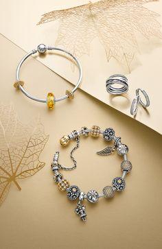 Add golden tones to your bracelet for a fashionable and lavish look. #PANDORA #PANDORAbracelet #PANDORAring #PANDORAaw14