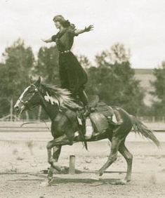 "Tillie Baldwin, a ""champion lady buckaroo,"" does some fancy riding at the 1912 Pendleton Round-Up, Oregon."