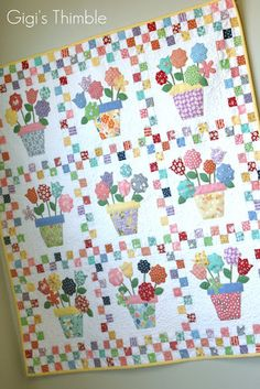 "Pot 'o Flowers by Glenna Hailey <3 37"" <3 1"" checkerboard border."
