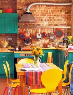 Teal Kitchen Cabinets. Bright yellow and red accents.