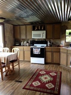 kitchen after mobile home renovation in rustic western country theme