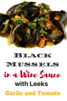 Black mussels in a savory wine sauce with leeks, garlic and fresh tomato. Click to find the full easy to make recipe!