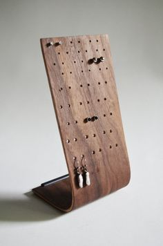 Available in Walnut or Maple top veneers, this simple stand features place holders for more than 24 pairs of earring to be displayed with varying sizes of holes to accommodate different backing types.