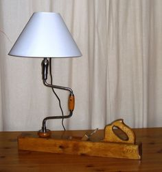 lampe rabot en chene et villebrequin Industrial Lighting Project Ideas Industrial Decor Project Ideas Project Difficulty: Simple www. Bedside Table Lamps, Bedroom Lamps, Antique Lighting, Rustic Lighting, Lighting Ideas, Rustic Lamps, Industrial Lighting, Steampunk Lamp, Wooden Lamp