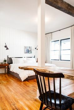 White bedroom with wood table