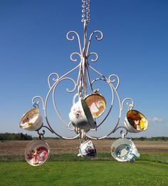 cute as a teacup chandelier but would be cuter hanging in kitchen as cup storage