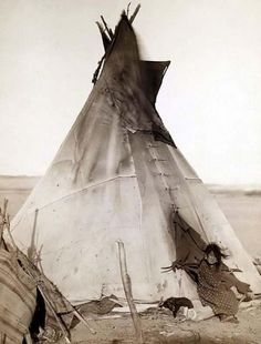 John C. H. Grabill - Original photograph of a Sioux Indian Tipi, 1891. The picture shows a young girl sitting by the Tipi, probably on or near the Pine Ridge Reservation.