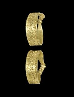 Viking Gold Cross-Stamped Finger Ring- 9th-11th century AD. A penannular flat-section finger ring with coiled ends, three bands of cross punchmarks to the hoop, in vertical and diagonal alignment. - See more at: http://realmsofgoldthenovel.blogspot.com/2014/03/viking-gold-finger-rings.html#sthash.oineUPI8.dpuf