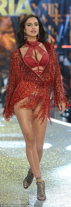 Baby news! Irina Shayk covered her tummy with a red tassled cape as E! News claim she is p...