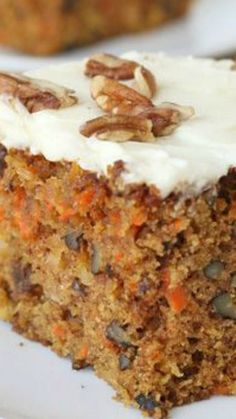 Carrot Cake Recipe Homemade Carrot Cake Recipe ~ moist, flavorful and oh so delicious… loaded with nuts, raisins, coconut and pineapple, then topped with rich and delicious cream cheese frosting! Sugar Free Carrot Cake, Carrot Cake With Pineapple, Homemade Carrot Cake, Easy Carrot Cake, Moist Carrot Cakes, Homemade Cake Recipes, Carrot Recipes, Coconut Recipes, Sweet Recipes