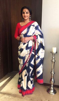 Vidya Balan in a boldly graphic red, black & white sari
