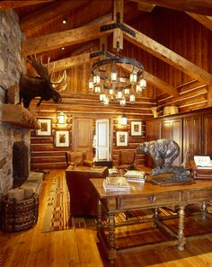 """The """"library and wine room"""" at the Stock Farm Club in the Bitterroot Valley, Montana.  Amazing moose on the fireplace!"""