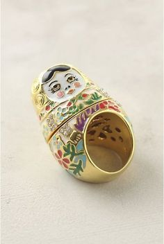 russian nesting doll ring  OMG.  I NEED THIS!!!!!  My aunt did work with Russian scientists while she was completing her PhD.  They brought her a ton of the dolls and Jaq and I LOVED playing with them.  So I need 2.  One for me and one for Sister.  :)
