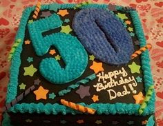 - Dads 50th birthday cake- double layer 14 cake with buttercream frosting, fondant decorations and Royal Icing 50.