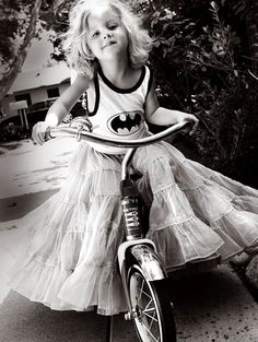 don't know who she is, but she's awesome.  batman shirt and a frilly skirt...love it : )