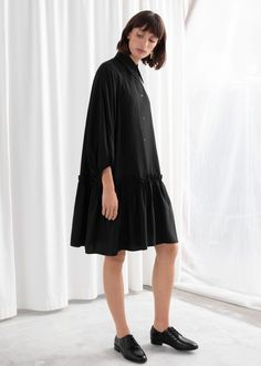 Voluminous puff sleeve mini length dress with a button-up collared bodice and dropped waist ruffle silhouette.Length of dress: / (size wears: EU 36 / UK 10 / US 4 / Small Fashion Story, Ruffle Skirt, Bodice, Your Style, Personal Style, Normcore, High Neck Dress, Womens Fashion, Mini Dresses
