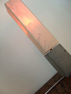 concrete table lamp with wood veneer lampshade.