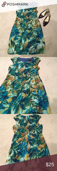 Leaf Print Dress Green and brown leaf print cap sleeve dress. Faux wrap style with lovely cascade ruffle on side. Polyester. Connected Apparel Dresses Asymmetrical
