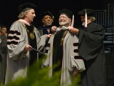 Berklee College of Music President Roger Brown, Lawrence Simpson and Kris Kristofferson confer an receive honorary doctor of music degree on Willie Nelson during the 2013 Berklee College Of Music Commencement at Berklee College of Music on May 11 in Boston.