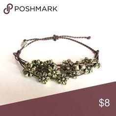 🔹Handmade bracelet🔹 Handmade bracelet: waxed polyester cord, antique goldtone flower charms. Waterproof, adjustable. 🌸 Price firm🌸 TheChicUrbanElephant Jewelry Bracelets