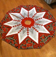 Quilted French Braid Christmas Tree Skirt, Christmas Tree Skirt, Quilted Tree Skirt, Tree Skirt, Poinsettia, Holly, Snowflake by RedHillRoots on Etsy https://www.etsy.com/listing/224586954/quilted-french-braid-christmas-tree